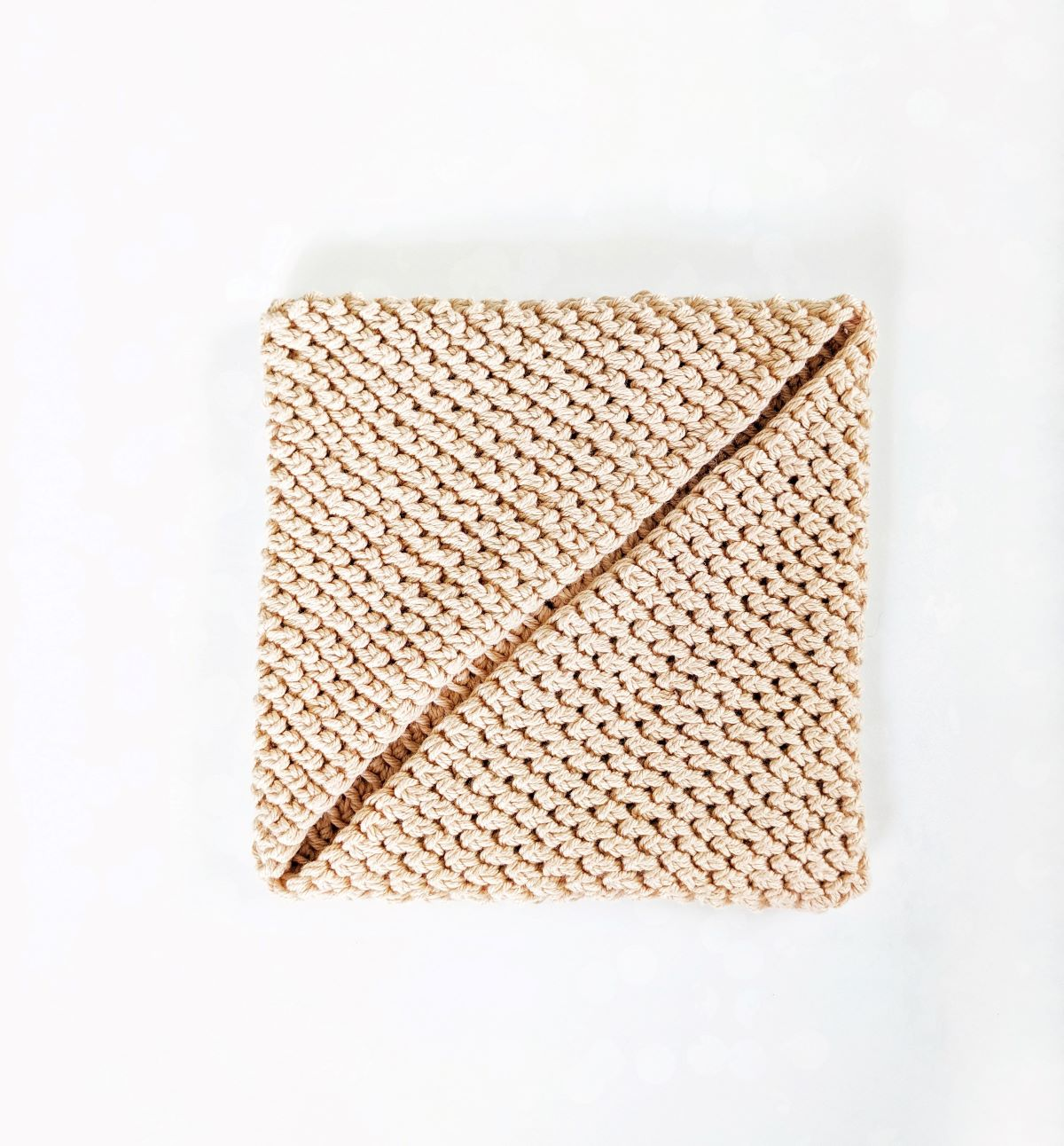 a crochet potholder that needs to be seamed together