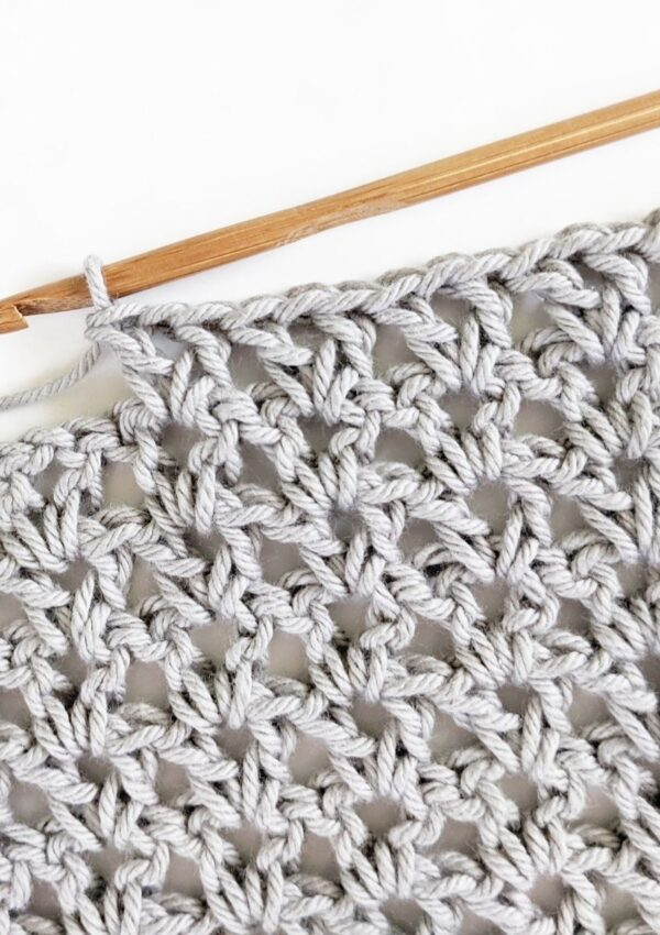 double crochet v-stitch swatch made with cotton yarn and a wooden crochet hook