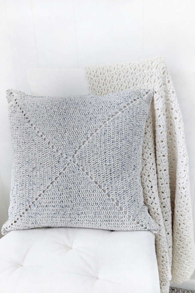 front view of classic granny square pillow