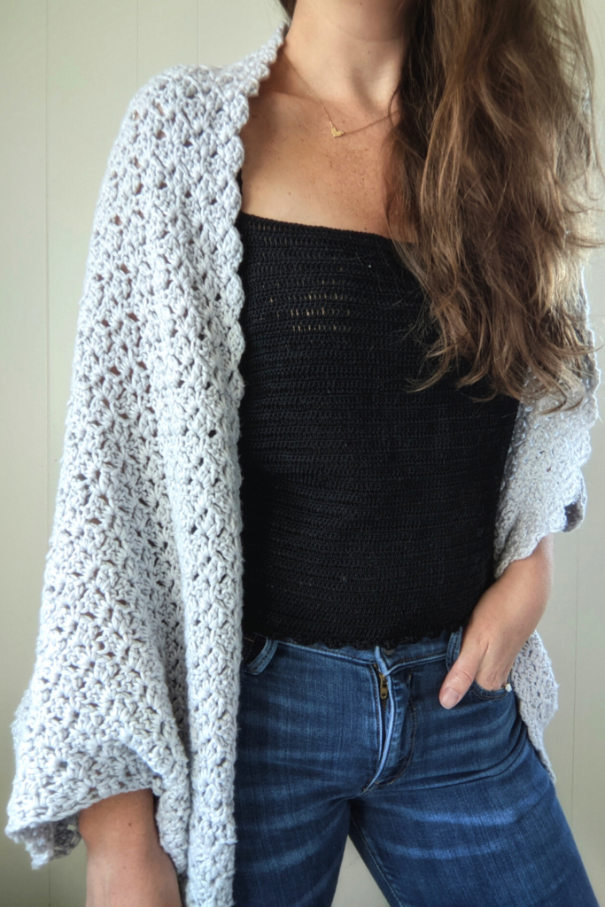 Model is wearing the crochet lace tank top with the blanket shrug pattern