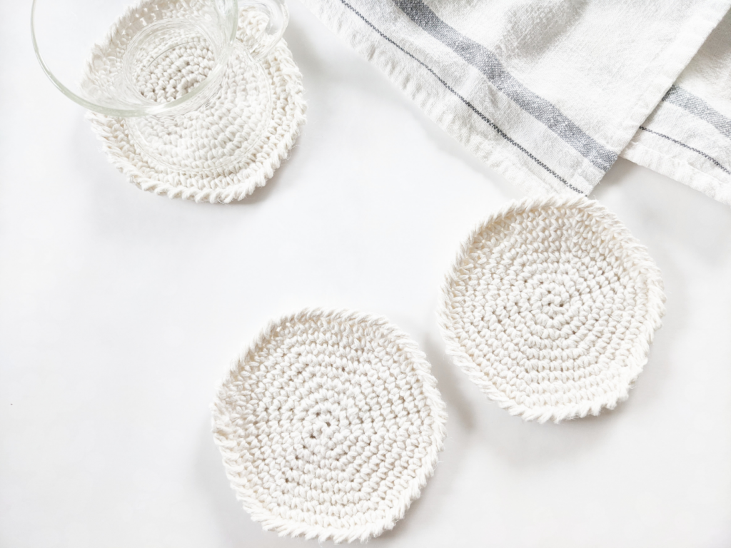easy crochet spiral coaster free pattern with a cotton kitchen towel