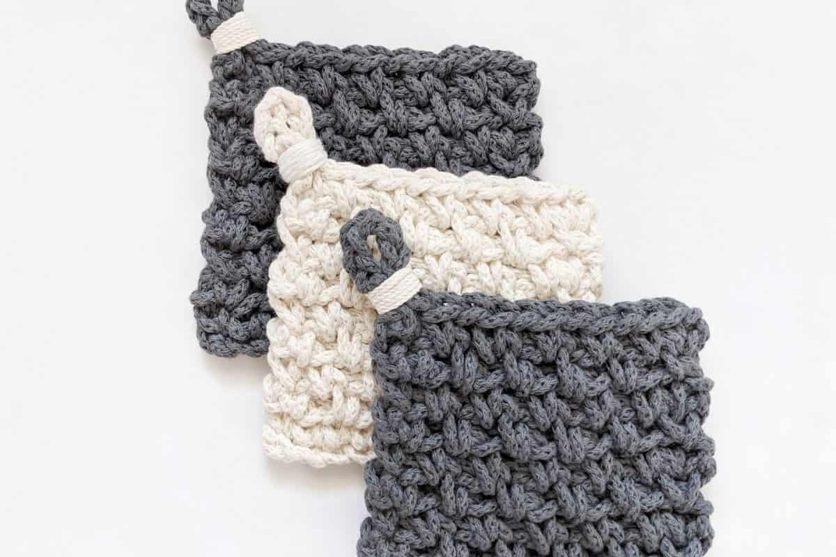 3 modern chunky crochet coasters made with cotton yarn in the color white and blue