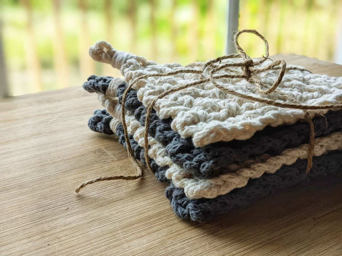 a stack of modern chunky crochet coasters with a twine wrapped around it