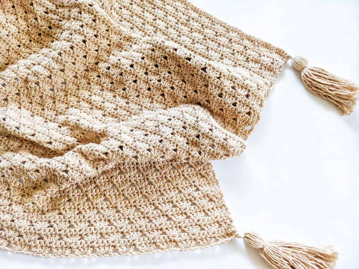 crochet shell stitch baby blanket made with Lion Brand Coboo yarn