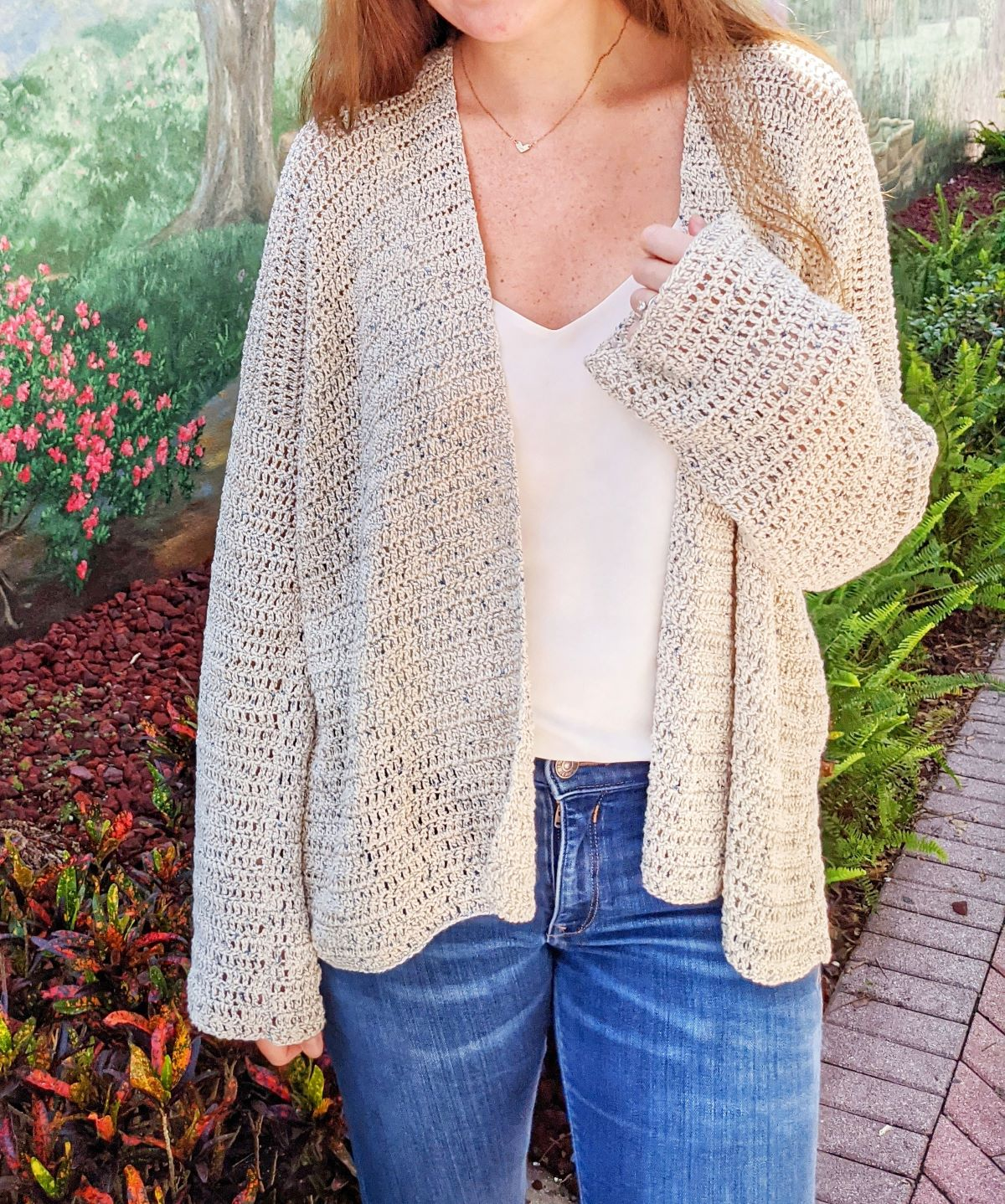 model is showing a front view of the beginner oversized crochet cardigan pattern