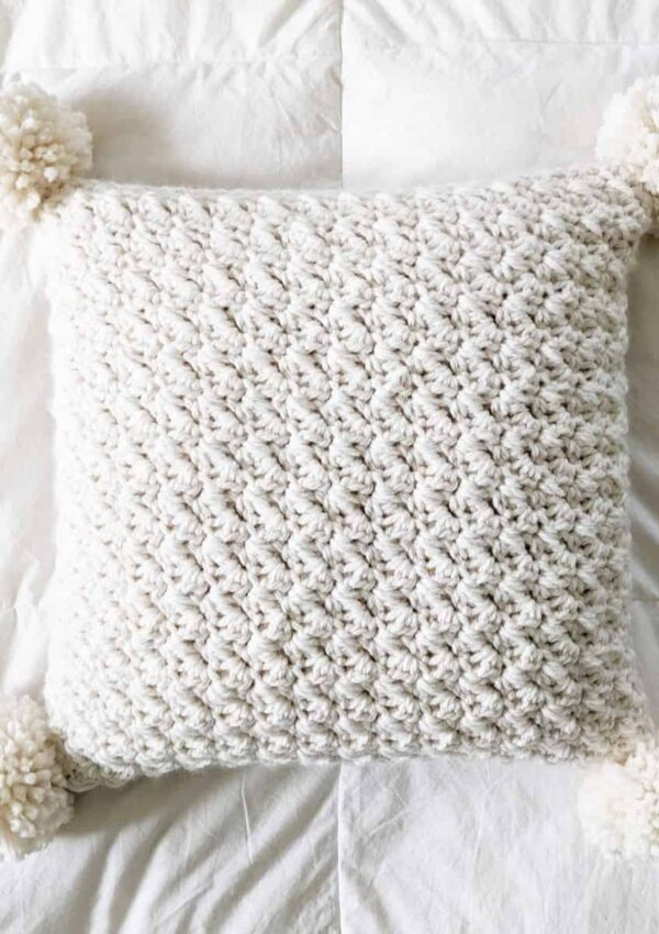 crochet chunky pillow with pom poms a free pattern
