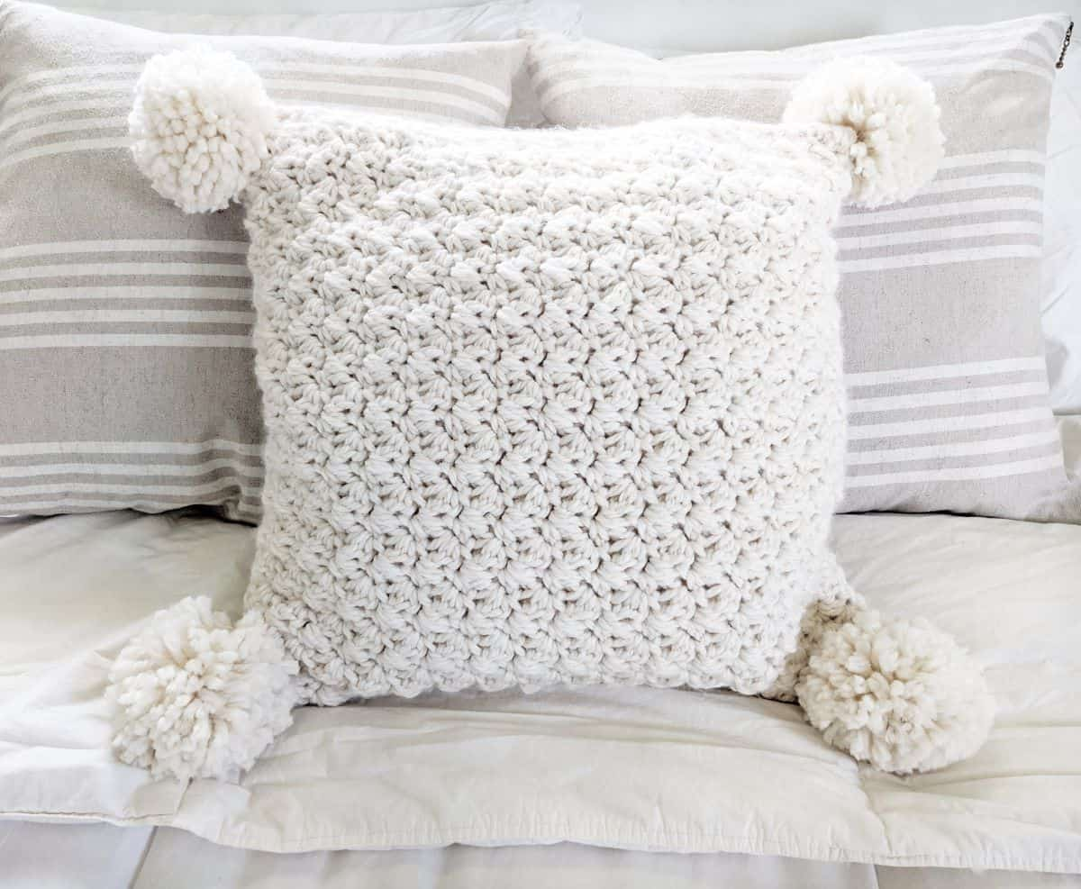 full view of the crochet chunky pillow on a bed