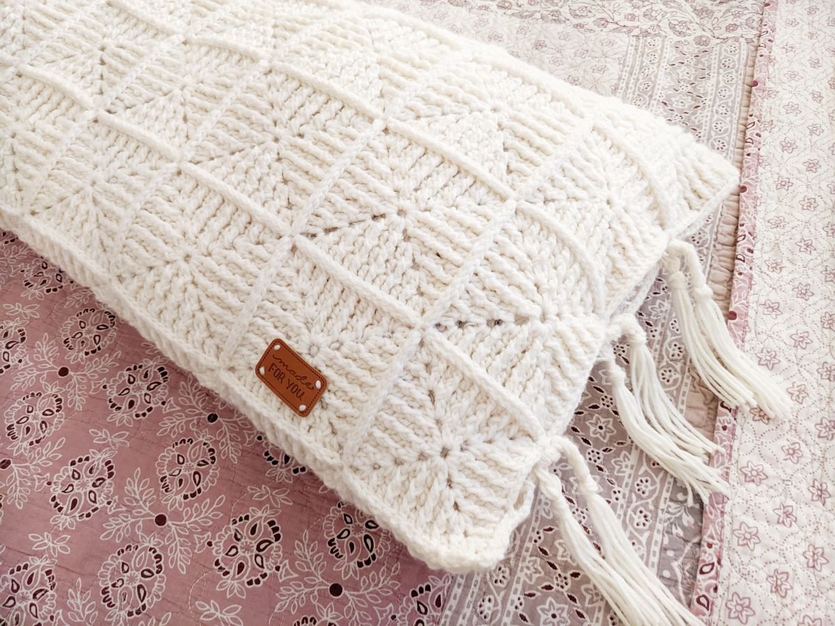 crochet body pillow made from granny squares in the color white
