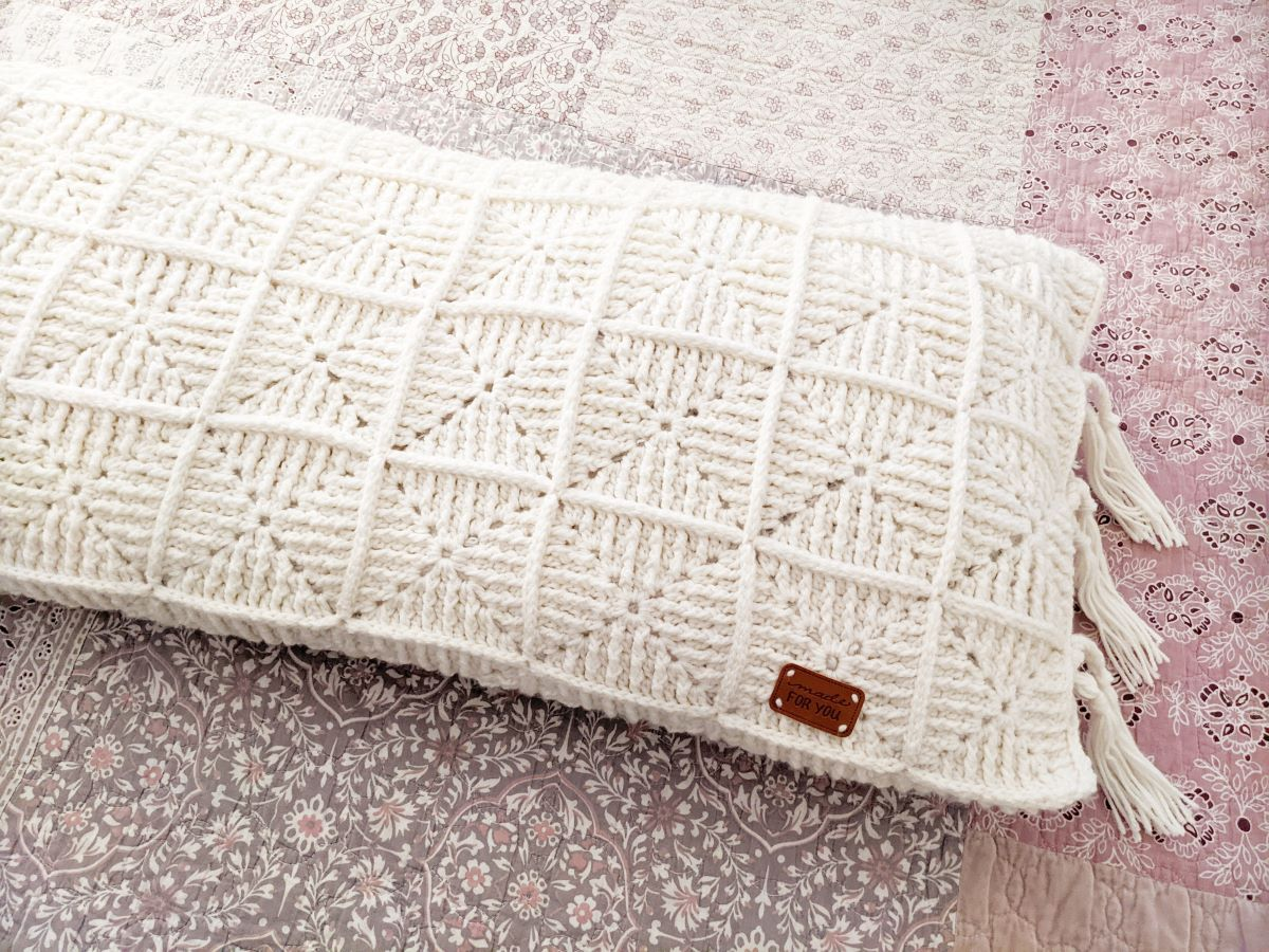crochet pillow made with granny squares