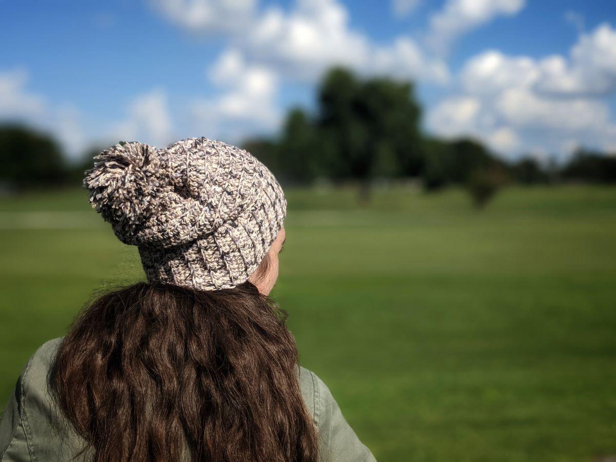 model is wearing a slouchy crochet beanie