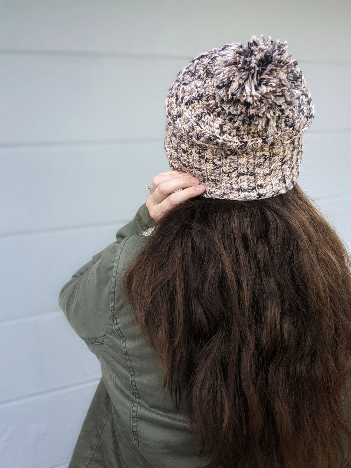 model is wearing a textured ribbed crochet beanie
